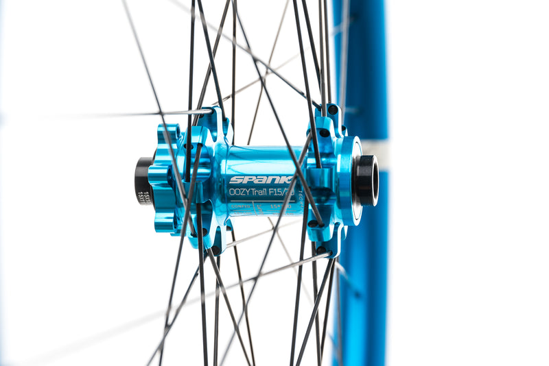 "Spank Oozy Trail 395+ Aluminum Tubeless 29"" Wheelset Blue sticker"