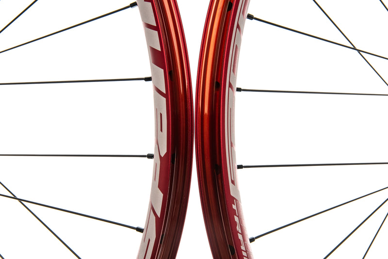 "Spank Oozy Trail 345 Aluminum Tubeless 29"" Wheelset Red front wheel"