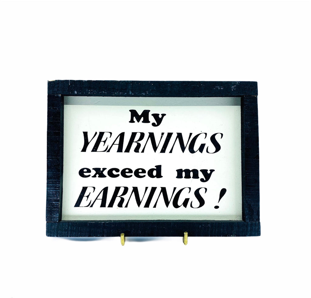 """My Yearnings Exceed My Earnings"" Wall Plaque"