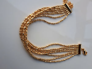 Multiple strands gold bracelets