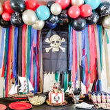 Pirate dessert table with balloon garland backdrop