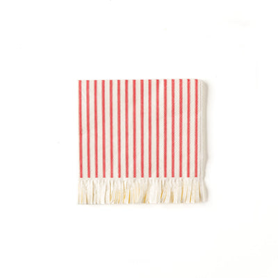 red and white fringed paper napkin with a holiday feel