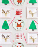 Christmas scatter with Santa plates and tree napkins party supplies