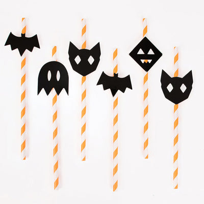 Orange and White Halloween Paper Straws with Halloween decorations