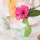 Palm tree paper cup party supplies and green case with pink flowers