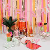 Streamer Backdrop with flamingo party supplies on table