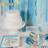 Oh baby white cake and party essentials on table