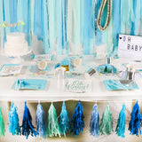 Baby Blue Table Set Up with Party Supplies and Decorations.