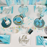 Table set up with party essentials for a boy baby shower