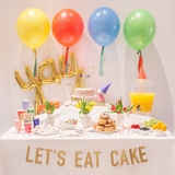 Let's Eat Cake Party Set Up with Jumbo Balloons and Party Essentials
