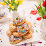 Large Plate of Sprinkle Donuts and Vases of tulips