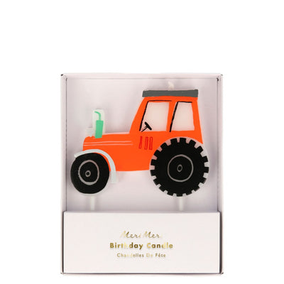 On the farm tractor birthday candle in reds, black and greens.