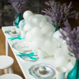 Magical Mermaid Table setting with balloon garland and party essentials