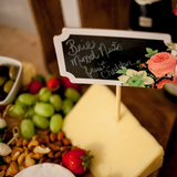 Cheese board with chalkboard sign