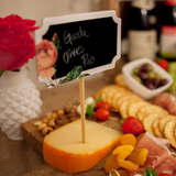 cheese, flowers and chalkboard party supplies