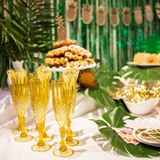Gold Acrylic Champagne Glasses on a Tropical Table Party