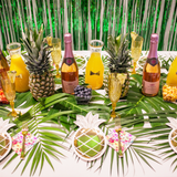 Tropical Table Party Set up with Palm leaves, pineapple plates and Floral Napkins
