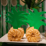 donuts transformed into pineapples for a tropical party