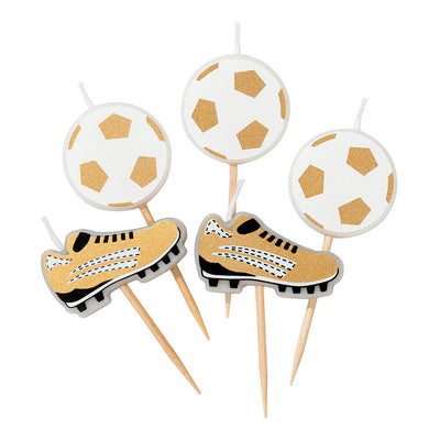 Gold and white soccer ball and soccer boot candles