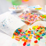Party time treat bags filled with neon coloured candies