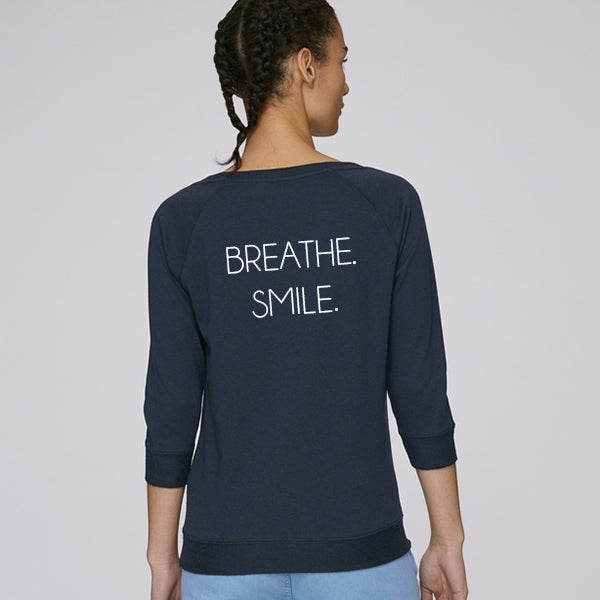 BREATHE. SMILE. sweatshirt navy is made out of tencel and organic cotton, soft and keeps you cool during activity. Great for both training & leisure.