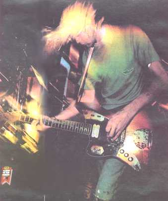 kurt cobain nirvana lead singer playing his fender jaguar road worn guitar