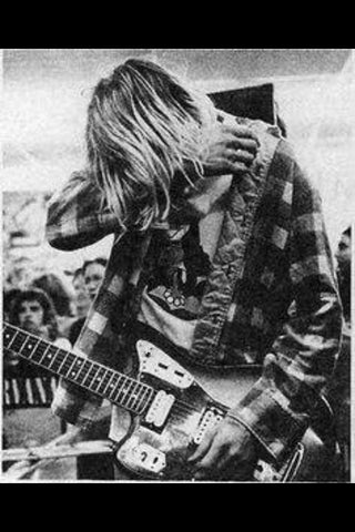 kurt in flannel rocks jaguar Seattle grunge style
