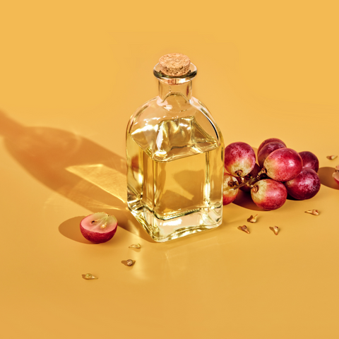 Grapeseed oil for hair, Grapes and bottle of oil.