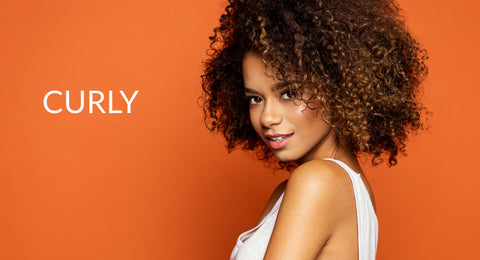 Curly with curly afro hair orange background