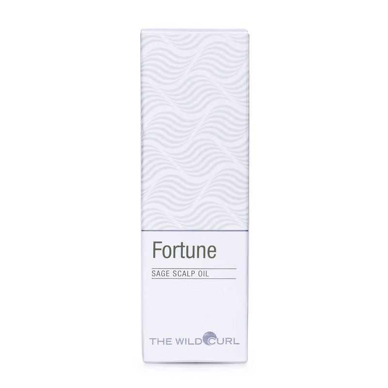 The Wild Curl Fortune Scalp Oil for dry and flaky scalp, 50 ml oil in white carton packaging with wavy print. Product image from front.