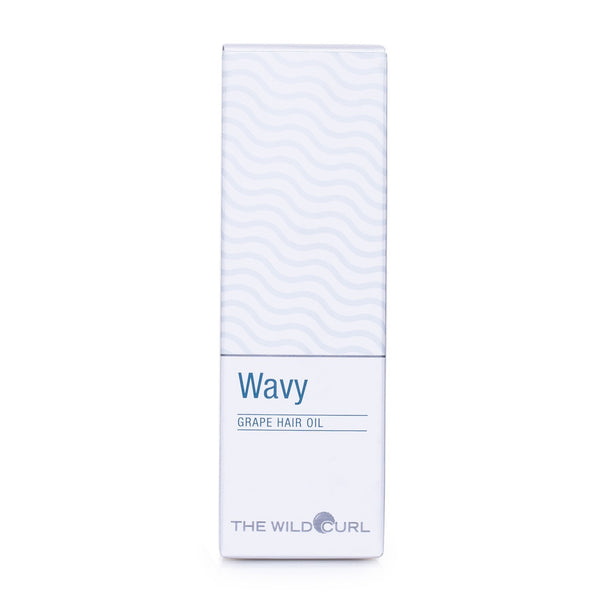 The Wild Curl Wavy Hair Oil 50 ml oil in white carton packaging with wavy print. Product image from front.