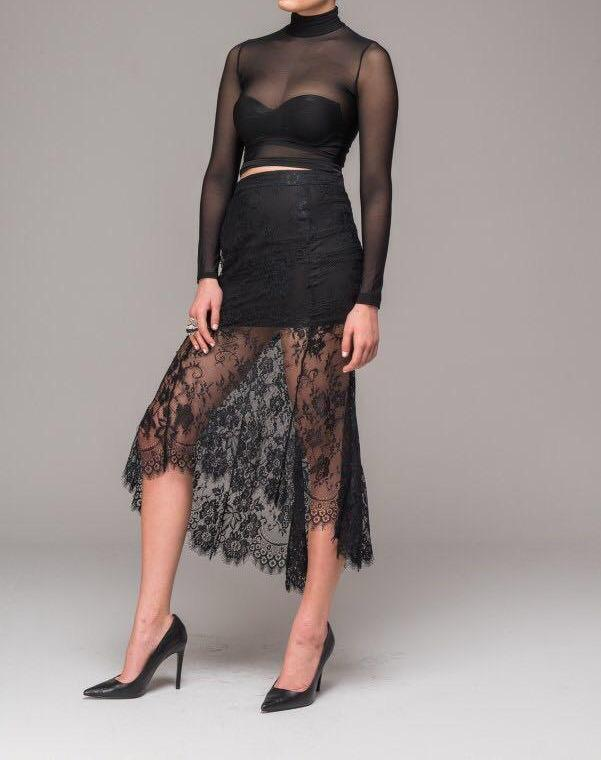 Side angle of sexy lace skirt with asymmetrical hem.