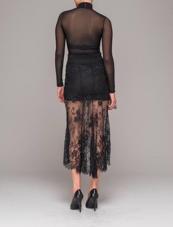 Sexy lace skirt with asymmetrical hem showing back view.