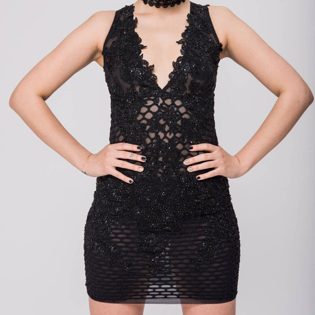 Semi sheer, Lacey black dress with floral appliqué design and beading all over. Unapologetically sexy!