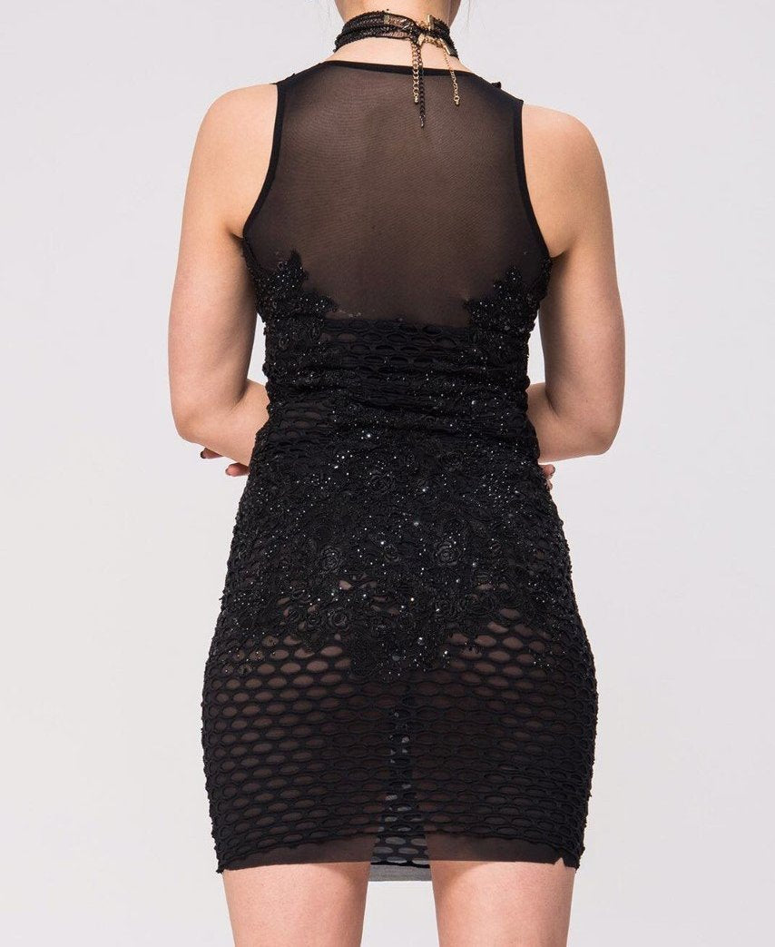 Semi transparent, little black dress with beading all over. Sexy and unapologetic!