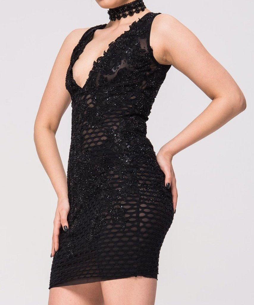 Side view of Lacey black dress with floral appliqué design and beading all over. Creates a sexy silhouette.