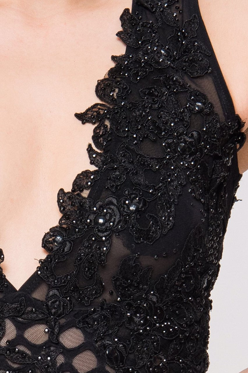 Close up of Lacey black dress v-neck detailing