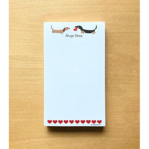 Small list notepad with two dachshunds facing each other with one holding a heart, 100 sheets, personalized notepad