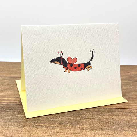 Black and tan dachshund dressed as ladybug note card.
