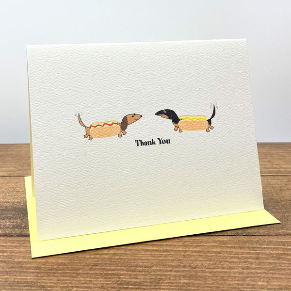 Two dachshunds dressed as hot dogs thank you cards.