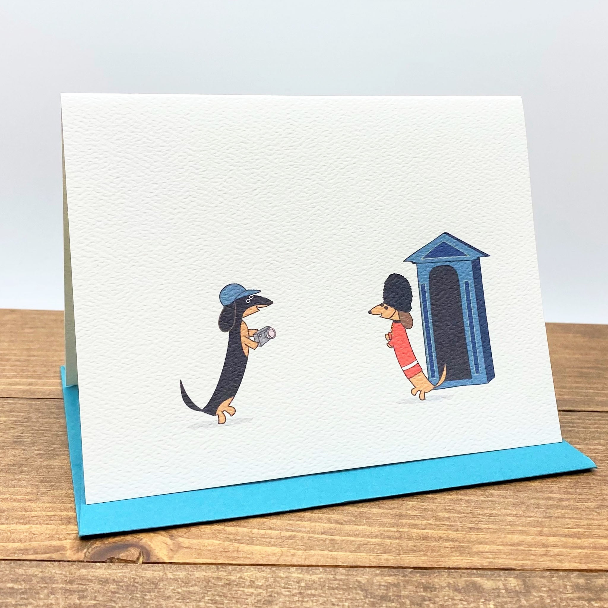 Dachshunds in London note cards featuring one dachshund dressed as tourist and the other as Queen's guard.