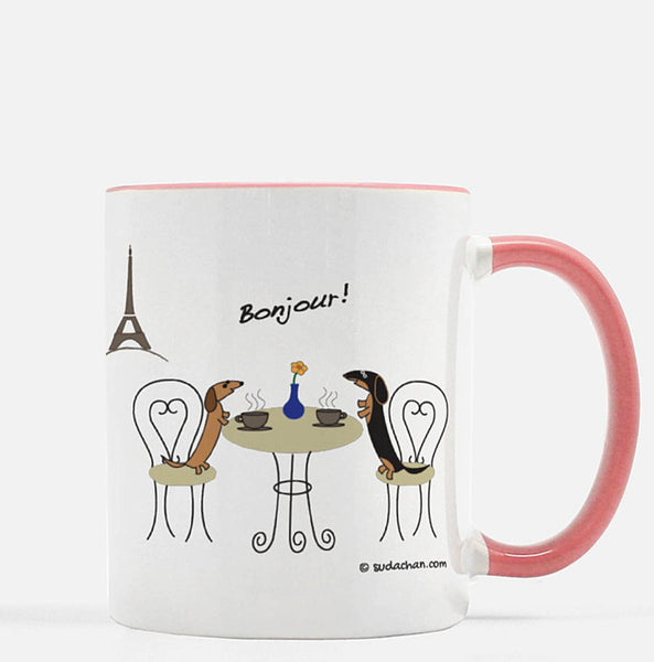 Two dachshunds in paris cafe pink and white ceramic mug.