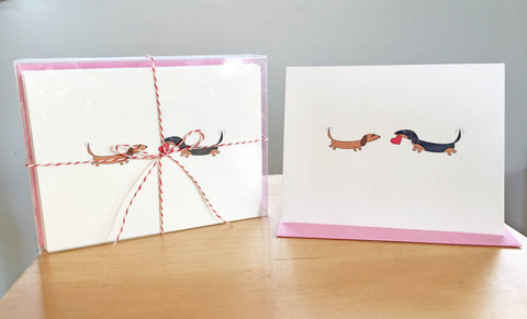 Two dachshunds with heart Valentine's Day card set with inside message.