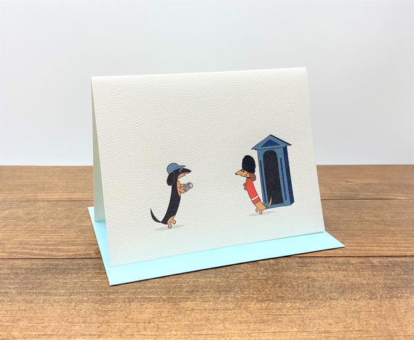 Two dachshunds in London cards.  Tourist dachshund and Queen's Guard dachshund.