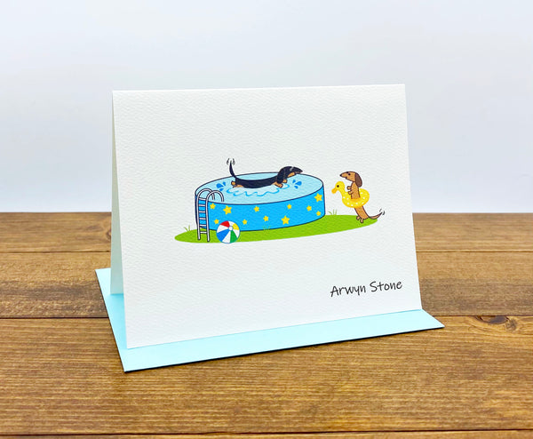 Dachshund pool party personalized cards.  One dachshund splashing in the pool and the other wearing a bright yellow swim floatie.