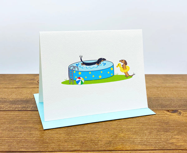 Dachshund pool party cards.  One dachshund splashing in the pool and the other wearing a bright yellow swim floatie.