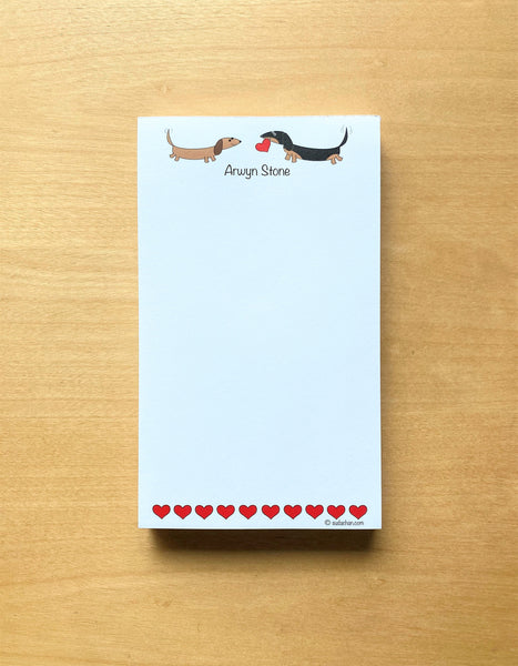 Two dachshunds with hearts personalized notepad.