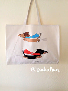 Screen printed large canvas tote with two super dachshunds flying with red and blue capes.