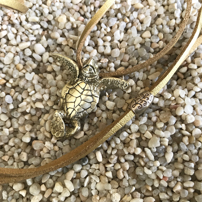 One eyed baby sea turtle in Brass on Vegan Suede