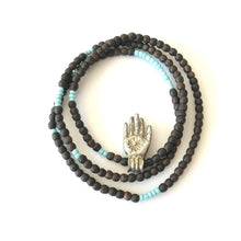 Fear not hand necklace on stretchy Ebony, Mali beads
